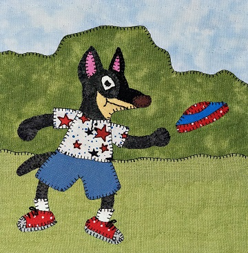 Cattle dog with flying disc applique quilt pattern