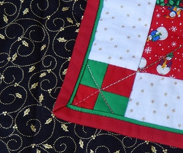 Setting square and binding Sharon's 4-patch Christmas quilt; Ms P Designs USA