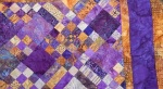 Butterscotch and Purple Quilt by Sharon