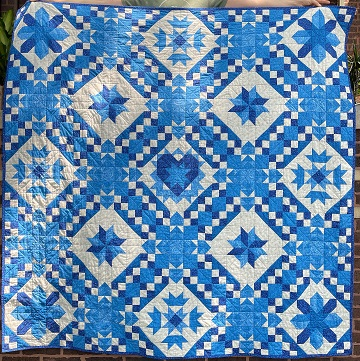 Blue Pieced Quilt by Ryan C